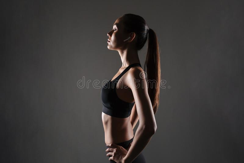 Side view portrait of a young asian fitness woman royalty free stock image