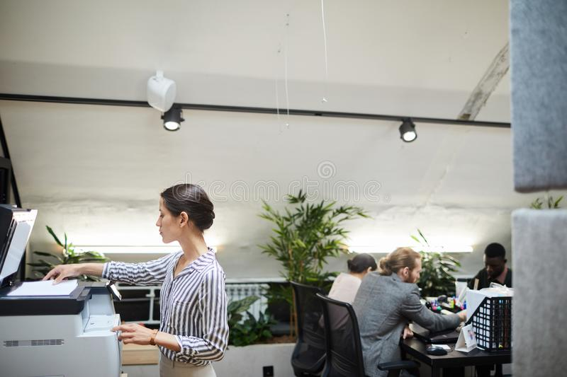 Businesswoman using Scanner in Office stock image