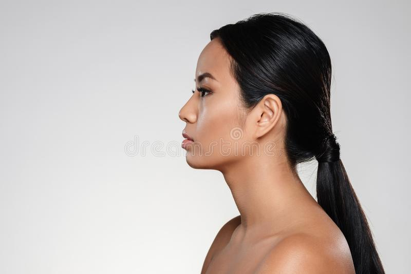 Side view portrait of a young half naked asian woman stock image