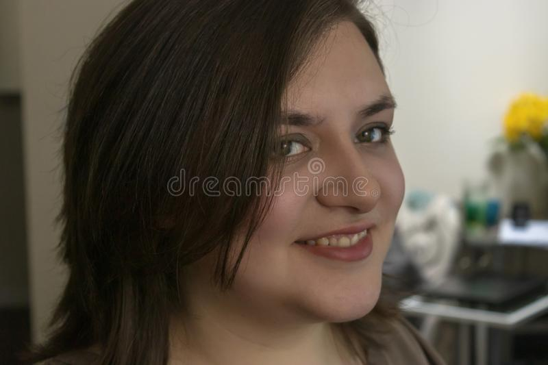Side view of pretty girl in home during daytime royalty free stock photo