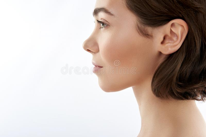 Side view of pretty sensual brunette female royalty free stock photo