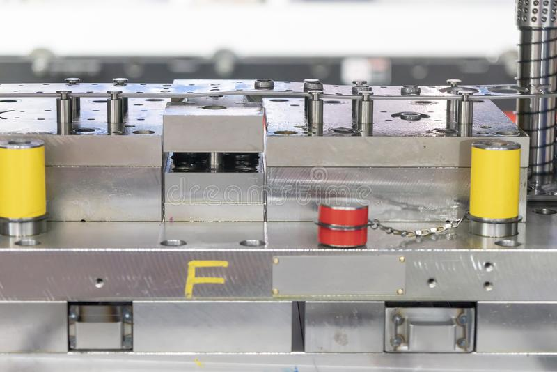 The side view of the progressive die. Stamping.Hi-technology sheet metal manufacturing process royalty free stock photo