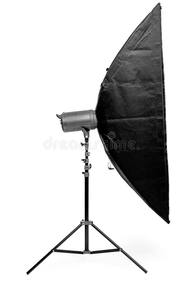 Side view of a rectangular soft box on a rack on a white background in the studio. Isolated royalty free stock photos
