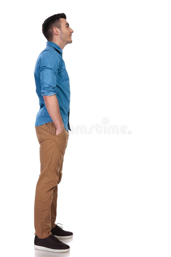 Side view of relaxed casual man looking up at something royalty free stock images