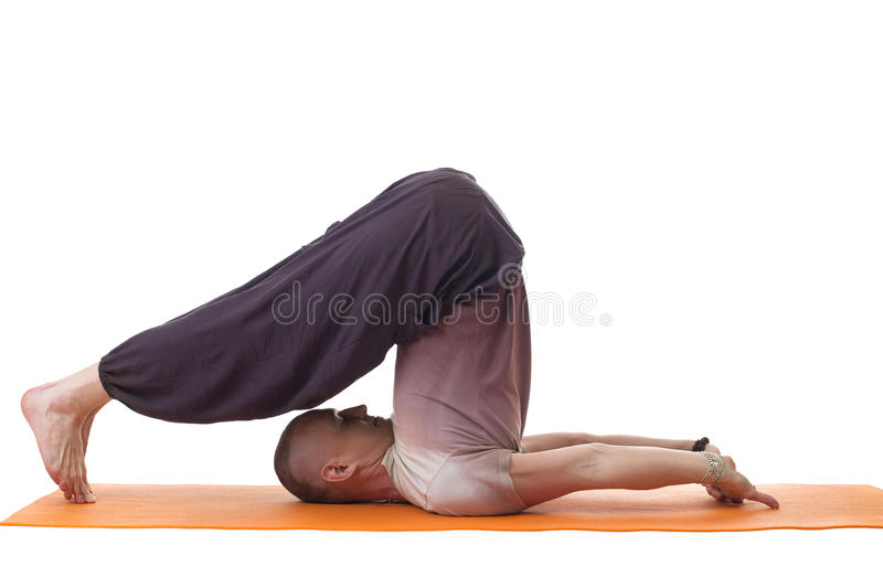 Side view of relaxed flexible yoga trainer. Posing in studio stock photos