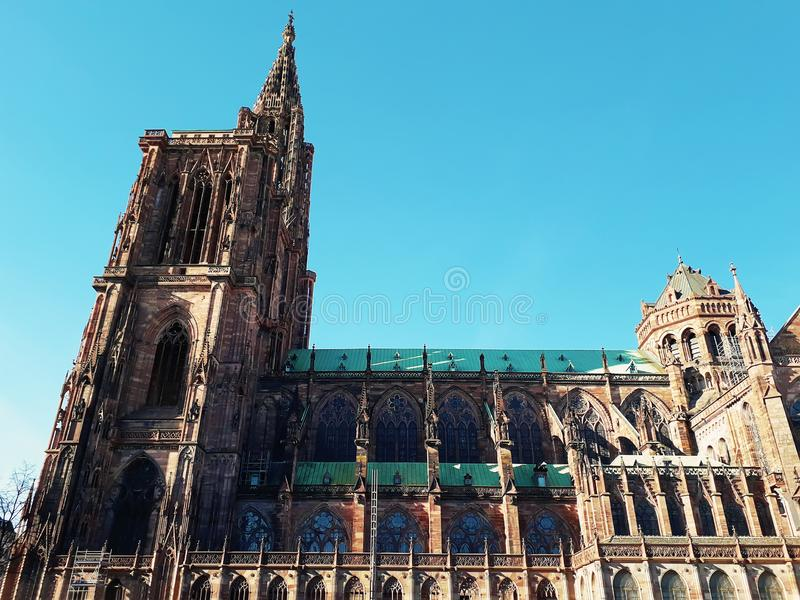 Side view of Roman Catholic Cathedral Notre Dame de Strasbourg in Alsace, France. Majestic gothic architecture royalty free stock photo