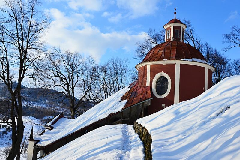Side view on round rear part of middle church of baroque calvary in Banska Stiavnica, Slovakia, during winter season 2018 royalty free stock image