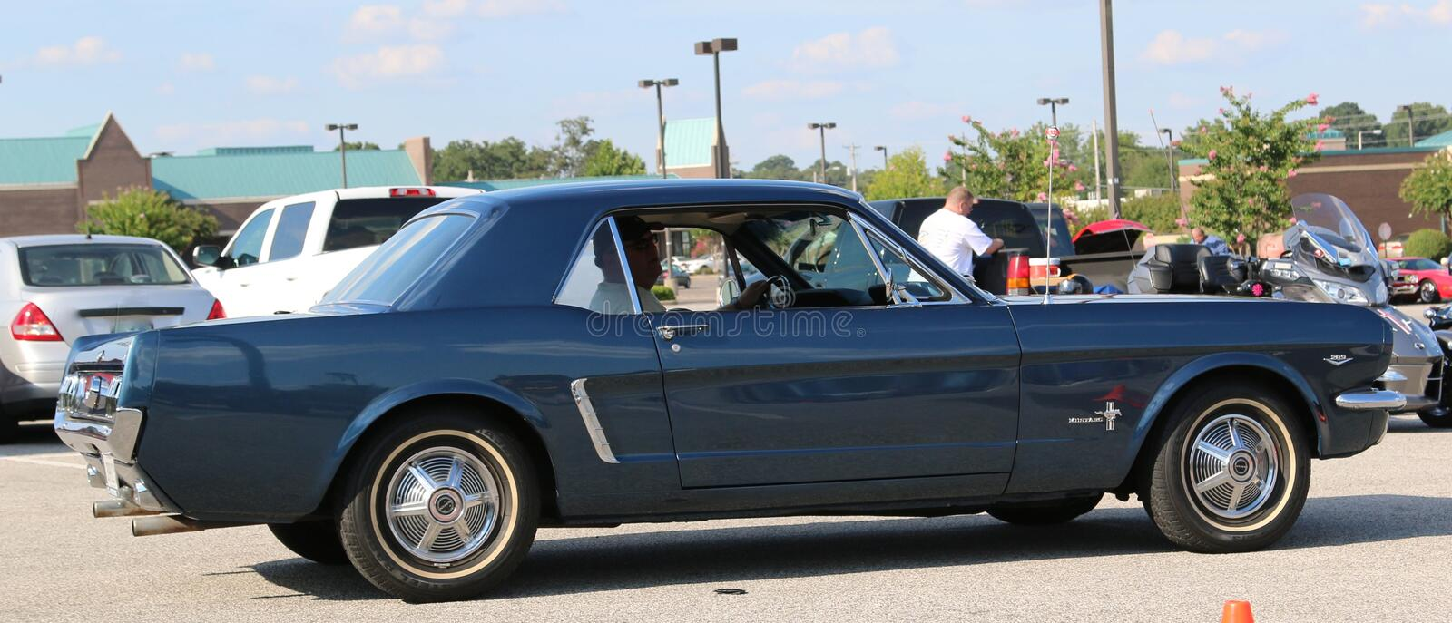 Side view of a 1960's model Blue Ford mustang royalty free stock images