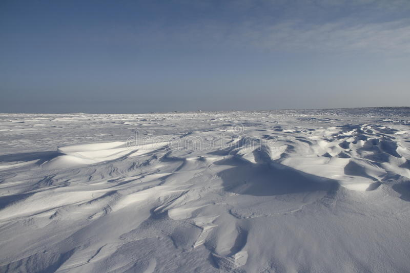 Side view of Sastrugi, wind carved ridges in the snow, near Arviat, Nunavut. Winter scene royalty free stock photos