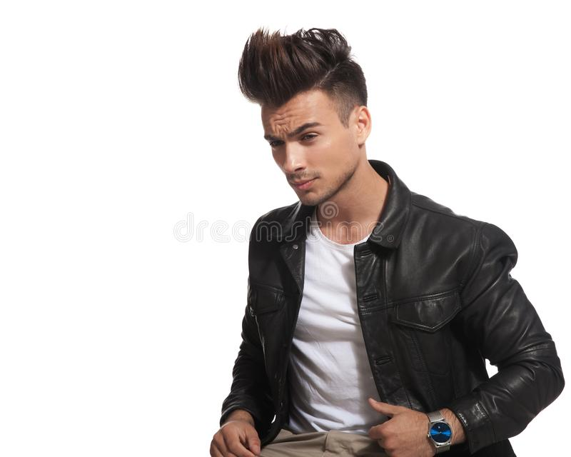 Side view of a seated man with cool hair style stock photos