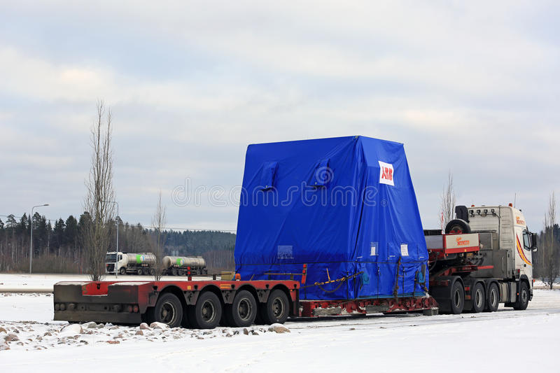Side view of Semi Truck Oversize Load Parked. FORSSA, FINLAND - NOVEMBER 12, 2016: Side view of Volvo FH16 semi trailer oversize load transport parked on truck royalty free stock images