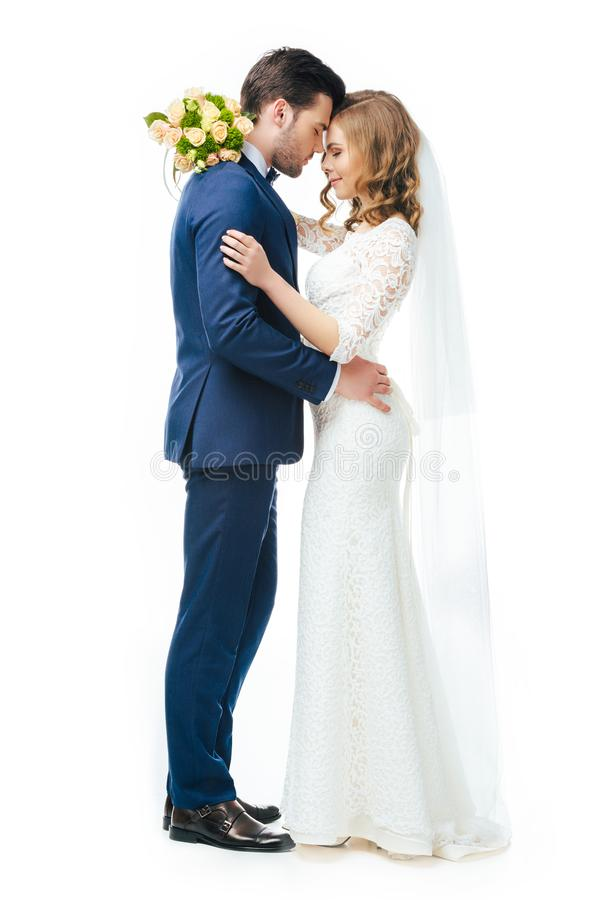 Sensual young wedding couple isolated on white royalty free stock image