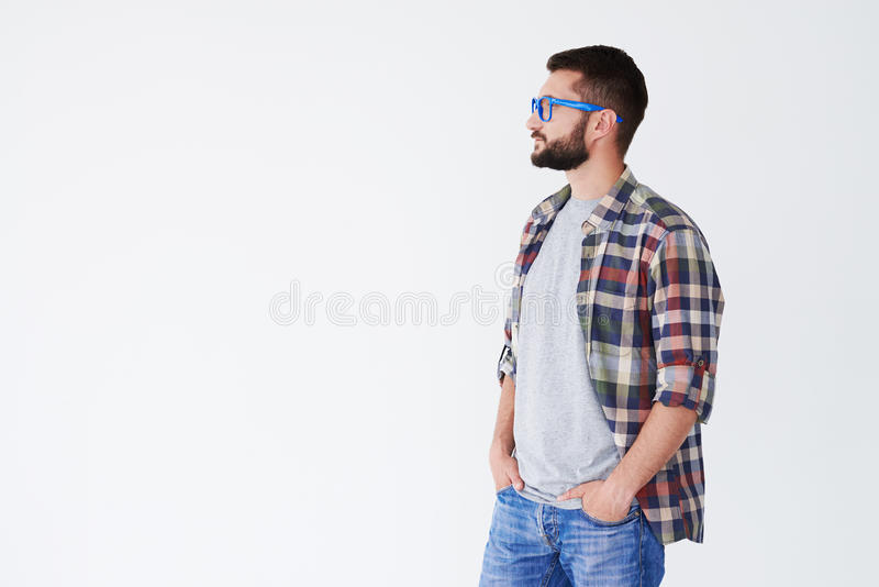 Side view of serious bearded man looking sideward at copy space royalty free stock image
