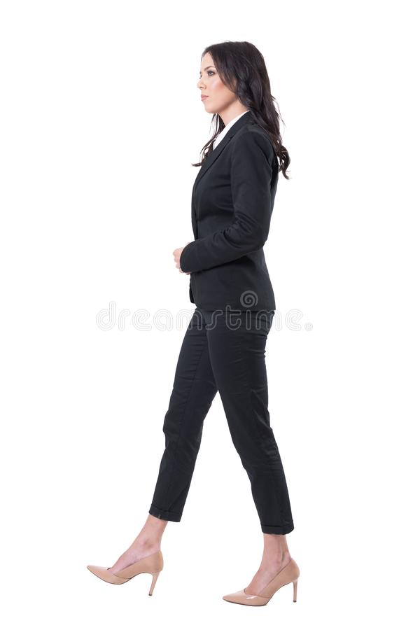Side view of serious confident successful business woman manager walking. royalty free stock image