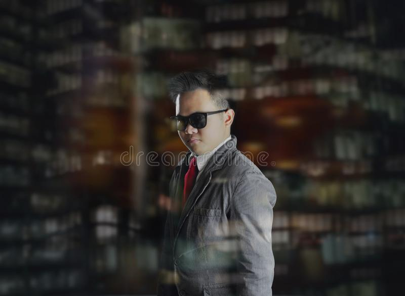 An elegant looking man at night time. Sophisticated. royalty free stock images