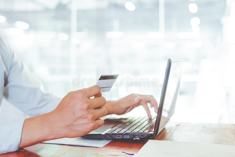 Side view shot of young businessman working on his laptop royalty free stock photo