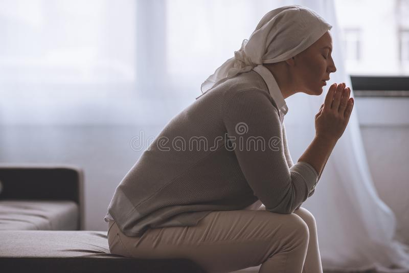 side view of sick mature woman stock photo