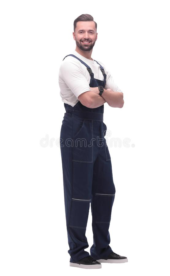 Side view. smiling man in overalls looking forward to copy space stock images