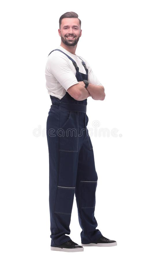Side view. smiling man in overalls looking forward to copy space stock photos