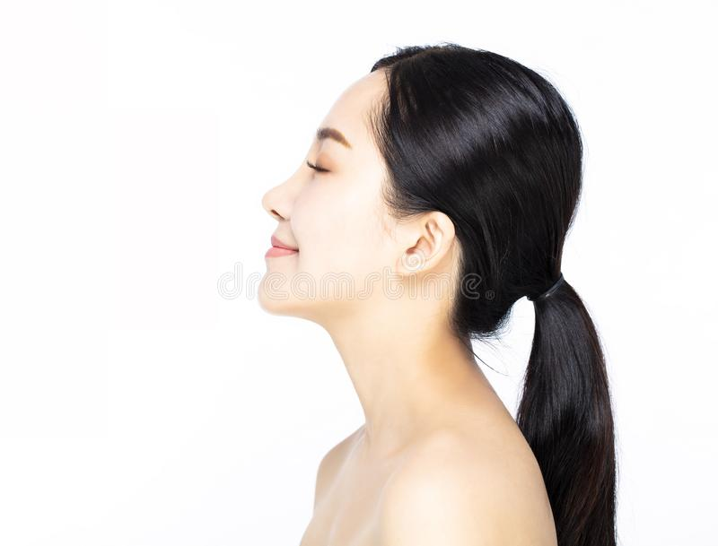 Side view of smiling young beauty face royalty free stock photo