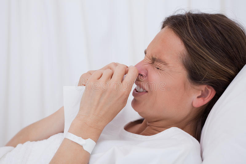 Download Side View Of Sneezing Woman Stock Image - Image: 22362679