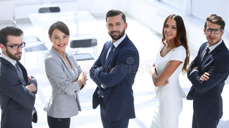 Side view. successful business people standing together stock photos