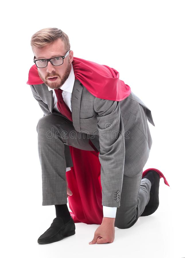 Side view . superhero businessman is ready to start. royalty free stock photography