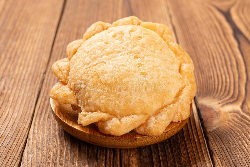 Sweet fried dumpling like a full filled purse for Chinese New Year. Side view sweet fried dumpling like a full filled purse for Chinese New Year stock photography