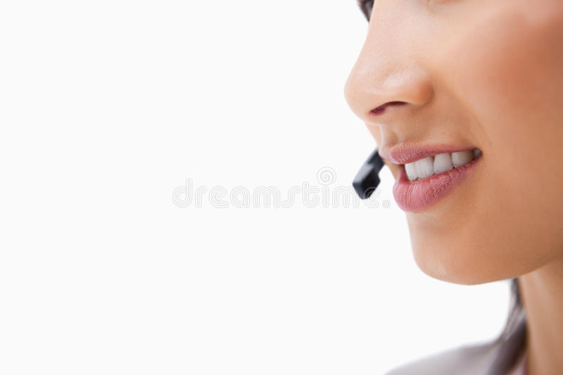Side view of talking mouth of female call center agent. Against a white background royalty free stock images