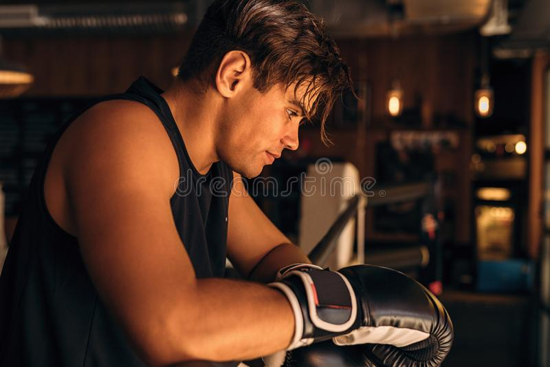 Side view of a tired and exhausted boxer royalty free stock images
