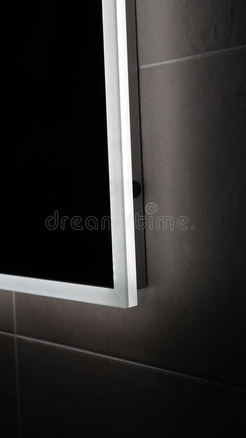 Side view of a touch light mirror in bathroom royalty free stock photo