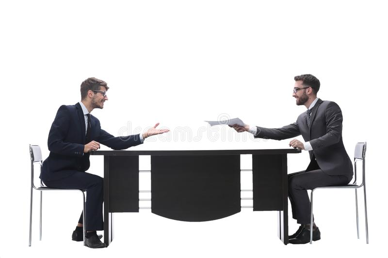 Side view. two business people discussing a business document royalty free stock photo