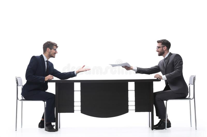 Side view. two business people discussing a business document royalty free stock photos