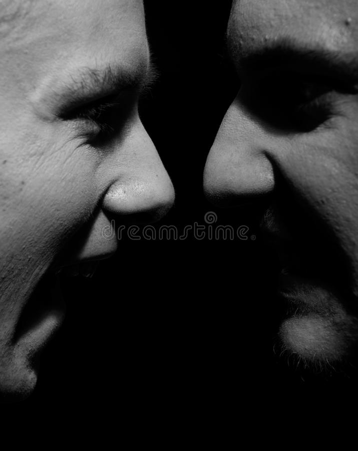 Side view on two screaming men royalty free stock photography