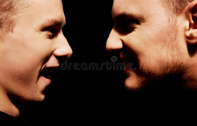 Side view on two screaming men stock photography