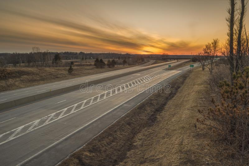 Sunset on a US motorway royalty free stock images