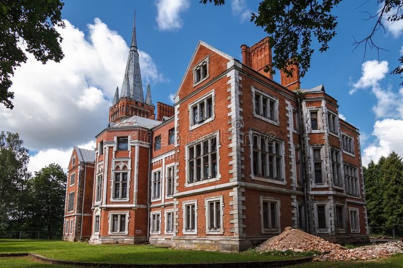 Side view on Tyszkiewicz palace in Lentvaris, Lithuania. Side view on abandoned a neo-gothic style palace in Lentvaris, eastern Lithuania royalty free stock images