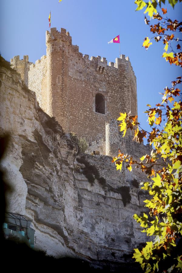 Side view of the village, on top of limestone mountain is situated Castle of the 12TH century Almohad origin, Alcala del Jucar, A. Alcala del Jucar, Spain stock photos