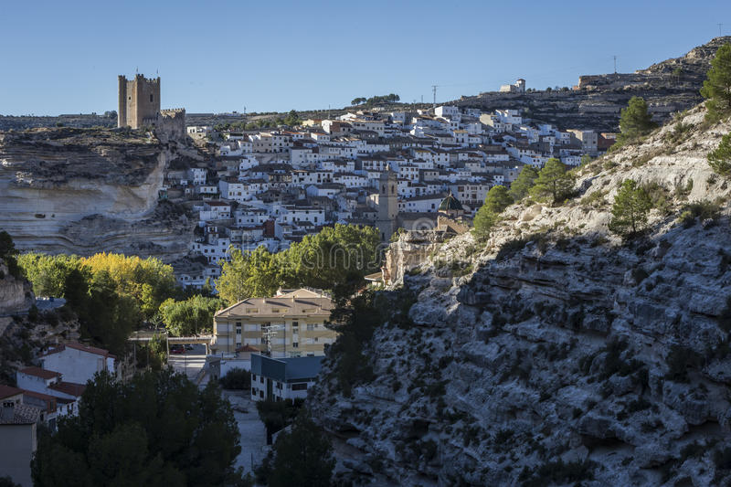 Side view of the village, on top of limestone mountain is situated Castle of the 12TH century Almohad origin, take in Alcala of t. Alcala del Jucar, Spain stock photos