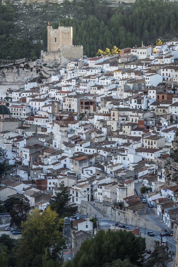 Side view of the village, on top of limestone mountain is situated Castle of the 12TH century Almohad origin, take in Alcala of t. Alcala del Jucar, Spain stock images