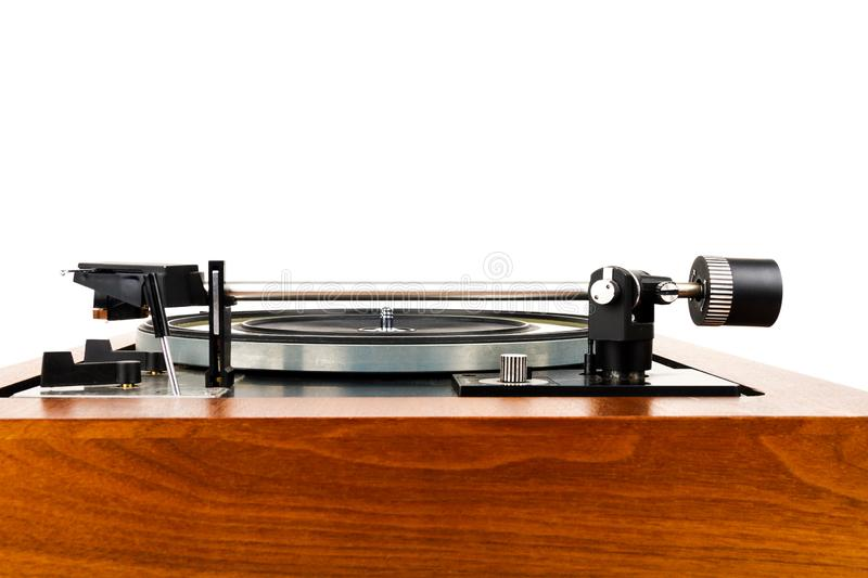 Side view of vintage turntable vinyl record player isolated on white. Wooden plinth. Retro audio equipment stock photography