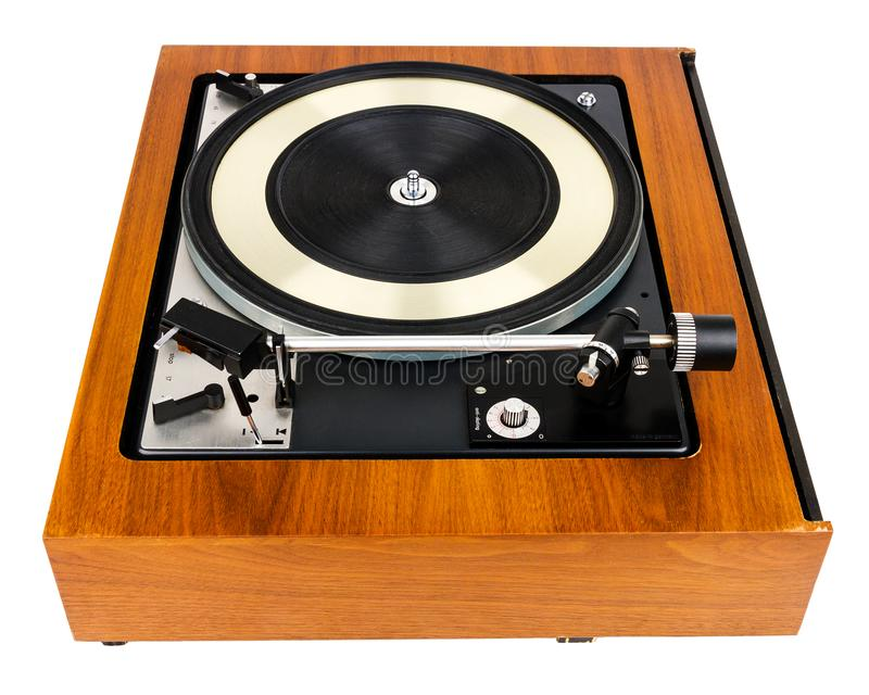 Side view of vintage turntable vinyl record player isolated on white. Wooden plinth. Retro audio equipment stock image