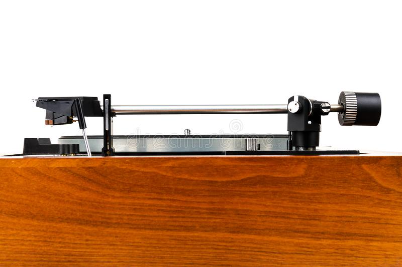 Side view of vintage turntable vinyl record player. Isolated on white. Wooden plinth. Retro audio equipment stock photo