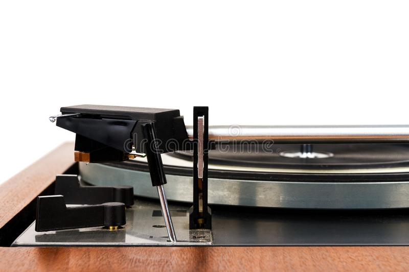 Side view of vintage turntable vinyl record player isolated on white. Wooden plinth. Retro audio equipment stock images