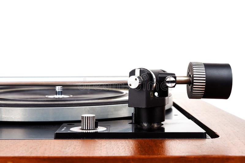 Side view of vintage turntable vinyl record player isolated on white. Wooden plinth. Retro audio equipment stock photos