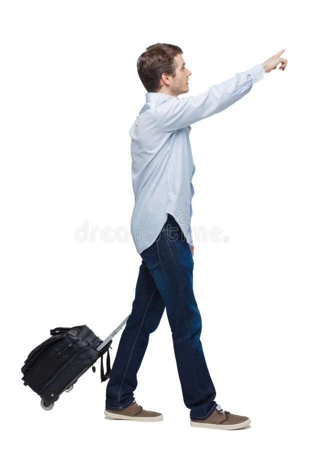Side view of walking business man with suitcase talking on the phone royalty free stock images