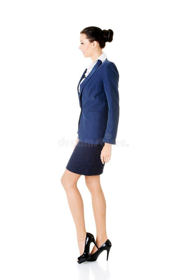 Side view of walking elegant businesswoman stock photos