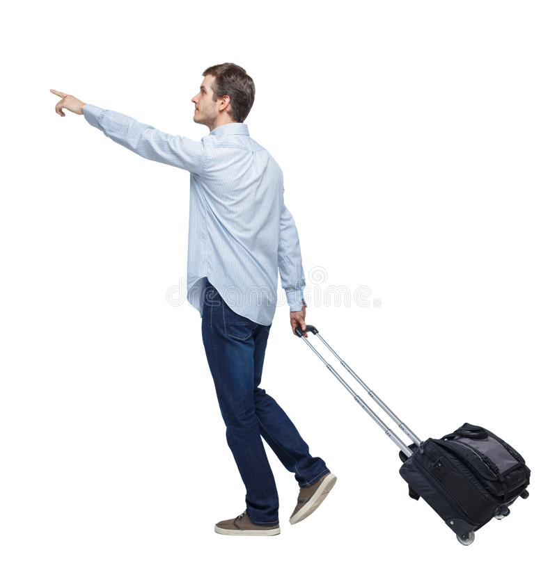 Side view of walking pointing business man with suitcase royalty free stock photos