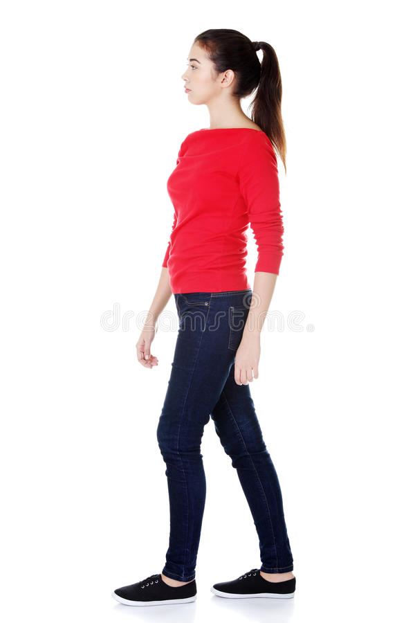 Side view of walking woman stock photo