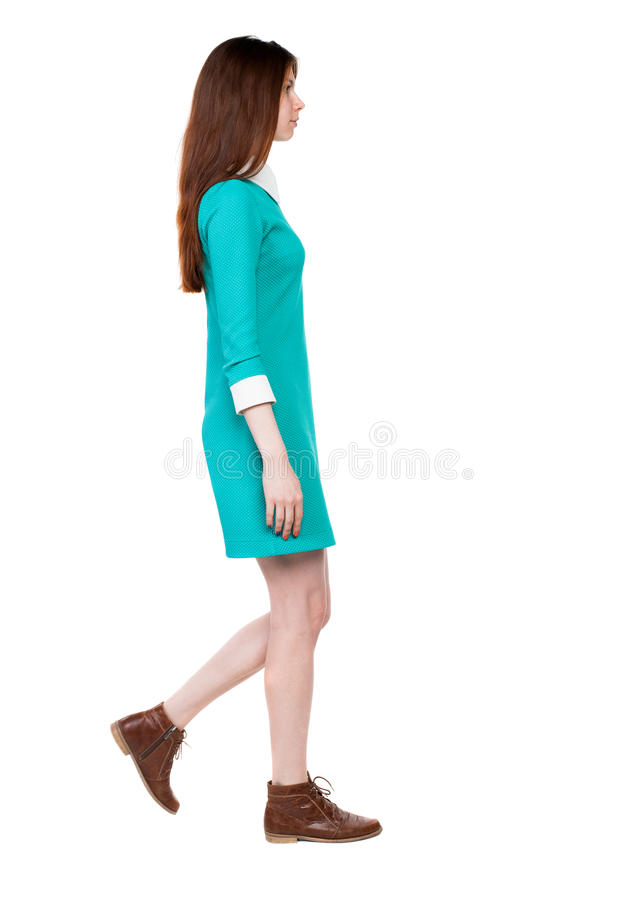 Side view of walking woman in dress. royalty free stock images